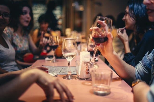 People drinking wine at restaurant
