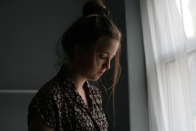 Sad woman by window